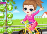 لعبة تعلم الطفلة ركوب الدراجات